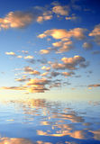Sunset. Sky mirrored on water level Stock Image