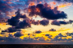 Sunset sky near ocean. Dramatic Colorful beautiful cloudy sky at sunset Stock Image