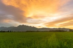 Free Sunset Sky On Field.Beautiful Sunset Sky With Dramatic Light Over Mountain.rural Landscape Background Royalty Free Stock Photography - 146057277