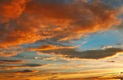 Sunset sky orange clouds over blue Stock Photo