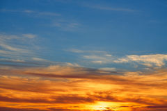 Sunset sky orange clouds over blue Stock Photography