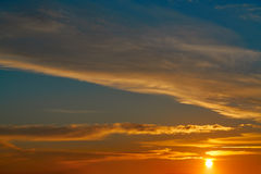 Sunset sky orange clouds over blue Royalty Free Stock Photography