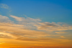 Sunset sky orange clouds over blue Stock Photos