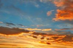 Sunset sky orange clouds over blue Stock Image