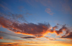Sunset sky orange clouds over blue Royalty Free Stock Image