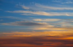 Sunset sky orange clouds over blue Royalty Free Stock Photo