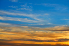 Sunset sky orange clouds over blue Royalty Free Stock Images