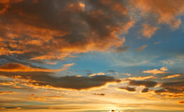 Sunset sky orange clouds over blue Royalty Free Stock Photos
