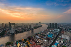 Sunset sky over Bangkok city river curved Royalty Free Stock Photography