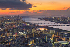 Sunset sky over Osaka city and river aerial view. Cityscape background Royalty Free Stock Photo