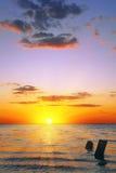Sunset sky over sea at dusk Stock Photos