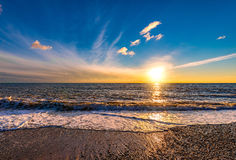 Sunset sky over the the sea. Sunset sky over the surface of the sea Stock Images