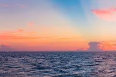 Sunset sky over seacoast skyline Royalty Free Stock Photo