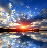 Sunset sky over water reflection Royalty Free Stock Photo