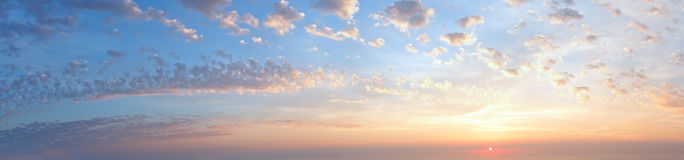 Sunset sky panorama with clouds Stock Images