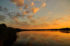 Sunset sky on pond Royalty Free Stock Image