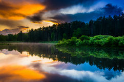 Sunset sky reflecting in a pond at Delaware Water Gap National R Royalty Free Stock Photo