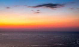 Sunset sky on sea Stock Images