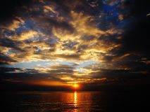 Sunset sky. Sea beach sunset and cloud Royalty Free Stock Image
