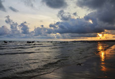 Sunset between sky and sea. Beutiful sunset on sea with grey clouds and sun way Stock Images