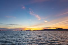 Sunset sky and sea. Seaside sunset with orange and blue clouds. royalty free stock image