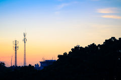 Sunset sky with silhouette antenna Royalty Free Stock Image