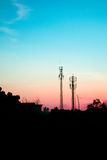 Sunset sky with silhouette antenna Stock Images