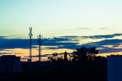 Sunset sky with silhouette antenna Royalty Free Stock Photos