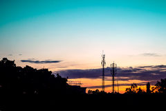 Sunset sky with silhouette antenna Stock Photos