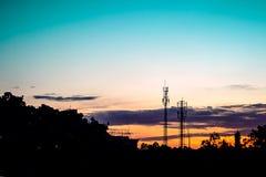 Sunset sky with silhouette antenna Stock Photos