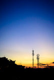 Sunset sky with silhouette antenna Stock Image