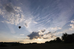Sunset sky and silhouette of a hot air balloon Royalty Free Stock Images