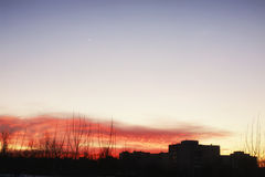 Sunset sky stars silhouettes of buildings Royalty Free Stock Photo