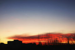 Sunset sky stars silhouettes of buildings Stock Image