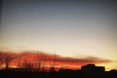 Sunset sky stars silhouettes of buildings Stock Photos