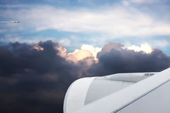 Sunset sky with storm clouds and another aircraft fly by. Stock Photography