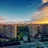 Sunset sky in summer time above the multi-storey city Royalty Free Stock Image