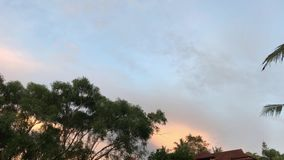 Sunset sky in the tropical resort. Bali island. 4K soft motion over the sky stock footage