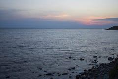 Sunset on the sea in summer stock photos