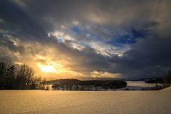 Sunset sky in winter time near Jonsvatnet lake in Norway stock images