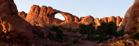 Sunset at Skyline Arch - stitched panorama. A sunset glow on Skyline Arch - one of over 2000 documented at Arches National Park, Utah state stock image