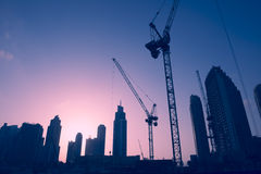 Sunset Skyline of Construction Cranes Royalty Free Stock Photo