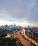 Sunset skyline of Kuala Lumpur city with Petronas Twin Towers or Stock Photos