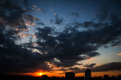 Sunset. Skyline with large and dramatic clouds Royalty Free Stock Image