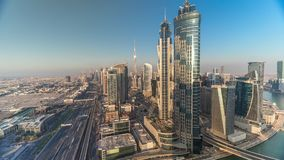 Sunset skyline with modern skyscrapers and traffic on sheikh zayed road timelapse in Dubai, UAE. Aerial view of business bay`s architecture stock video