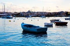 Sunset in Sliema, Malta. Boats in Sliema harbor, Malta. Beautiful sunset Stock Images
