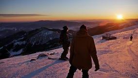 Sunset Slope Skier Snowboarder Beautiful Winter Panorama Slowmotion stock video footage