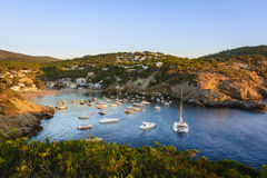 Sunset in the small bay of Cala Vedella, Ibiza island. Royalty Free Stock Photo