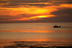 Sunset and Small Boat Royalty Free Stock Images