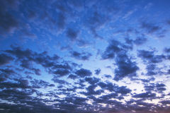 Sunset of small clouds in the blue sky Royalty Free Stock Images